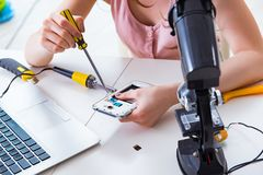 The mobile phone repair in workshop. Mobile phone repair in workshop stock photos