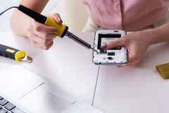 The mobile phone repair in workshop. Mobile phone repair in workshop stock photo