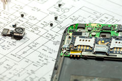 Mobile phone repairing. Broken Mobile phone repairing, disassembled phone stock photography