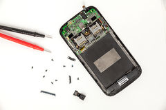 Mobile phone repairing. Broken Mobile phone repairing, disassembled phone royalty free stock images