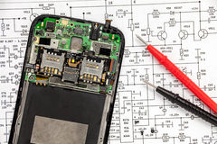 Mobile phone repairing. Broken Mobile phone repairing, disassembled phone royalty free stock photography