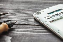 Mobile phone repairing Stock Image