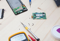 Mobile phone repairing Stock Images