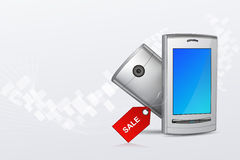 Mobile phone with sale tag Royalty Free Stock Images