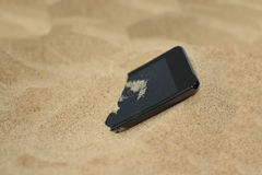 Mobile phone in sand. Stock Photography