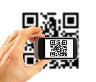 Mobile phone scanning QR code Royalty Free Stock Photo