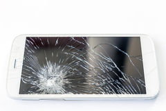 Mobile phone screen is broken. A white mobile phone is broken screen on white background stock photography