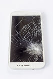 Mobile phone screen is broken. A white mobile phone is broken screen on white background stock image