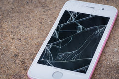 Mobile phone. Mobile phone screen is cracked on concrete Stock Photos