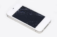 Mobile phone screen is cracked. On white background Stock Photography