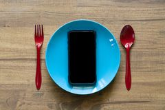 Mobile phone served on plate. Concept and idea for communication stock image