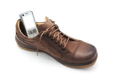 Mobile phone in shoe Stock Photography