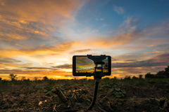 Mobile phone shooting photo and time-lapse Beautiful color sunse Stock Photo
