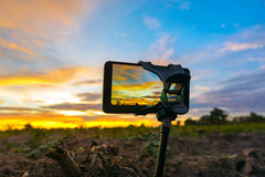 Mobile phone shooting photo and time-lapse Beautiful color sunse. T sky Royalty Free Stock Photography