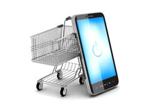 Mobile phone and shopping cart Royalty Free Stock Photos