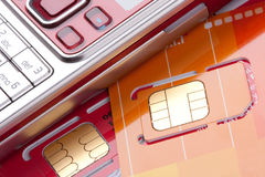 Mobile phone with sim cards Royalty Free Stock Photos