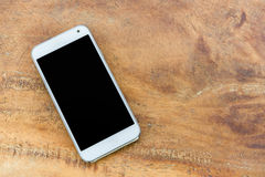 Mobile phone, smart phone. White mobile phone on wood background Stock Photography