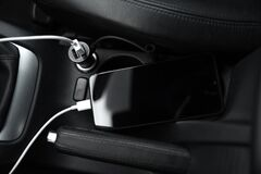 Free Mobile Phone, Smartphone Charge Battery, Charging In The Car Plug Close Up Stock Photography - 173728642