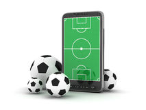 Mobile phone and soccer balls. On white background Royalty Free Stock Images