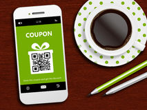 Mobile phone with spring discount coupon, coffee and pencils Stock Images