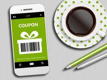 Mobile phone with spring discount coupon, coffee and pencils Royalty Free Stock Image