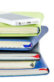 Mobile phone and stack of books Royalty Free Stock Photo