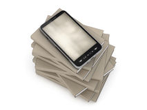 Mobile phone on stack of books Royalty Free Stock Photo