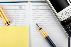 Mobile phone and stationery Stock Photo