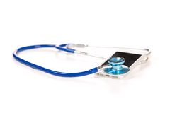 Mobile phone with stethoscope isolated on white background. Royalty Free Stock Photo