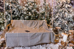 Mobile phone in a swing with a blanket in a snow-covered park wh Royalty Free Stock Photo