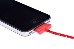 Mobile Phone and sync cable Royalty Free Stock Image