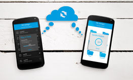 Mobile phone sync through the cloud. Two mobile phone sync through the cloud Stock Photos
