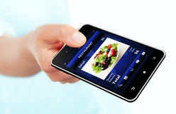 Mobile phone with takeaway restaurant order screen isolated over. White background Stock Photo
