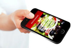 Mobile phone with takeaway restaurant order screen isolated over. White background Royalty Free Stock Photos