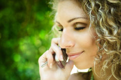 Mobile phone talking Stock Images