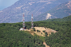 Mobile phone telecommunication radio antenna towers on mountain, Stock Photos