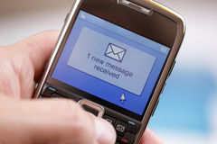 Mobile phone text message or e-mail Royalty Free Stock Photos