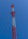 Mobile phone tower. On blue sky background Stock Images