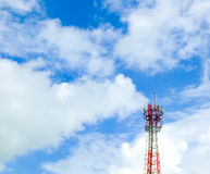 Mobile phone tower and cloudy blue sky Royalty Free Stock Images