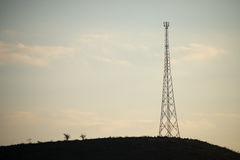 Mobile phone tower on hill Stock Photography