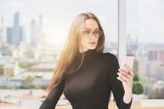 mobile phone using woman young Στοκ Εικόνα