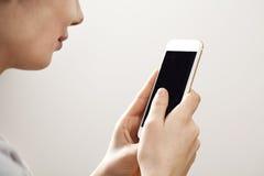 mobile phone using woman young Στοκ Φωτογραφία