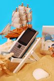 Mobile phone on vacation Stock Photos