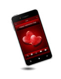 Mobile phone with valentine's day wishes. Over white background Stock Images