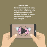Mobile phone with video player on the screen in the human hands. Place for text Royalty Free Stock Images