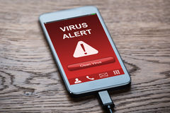 Mobile Phone With Virus Infected. Close-up Of A Mobile Phone With Virus Infected And Cleaning Option royalty free stock photos