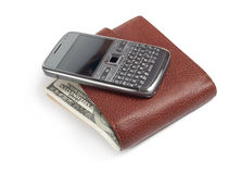 Mobile phone on wallet Royalty Free Stock Photography