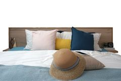 Mobile phone , weave hat , pale pink cushion and blue fabric on. The comfortable bed with white background stock images