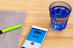 Mobile phone at which the human resources department calls and in German language HR department calls stands in English: Mobile p. Mobile phone at which the Royalty Free Stock Photography