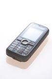 Mobile phone on white. Black mobile phone on white Stock Photo